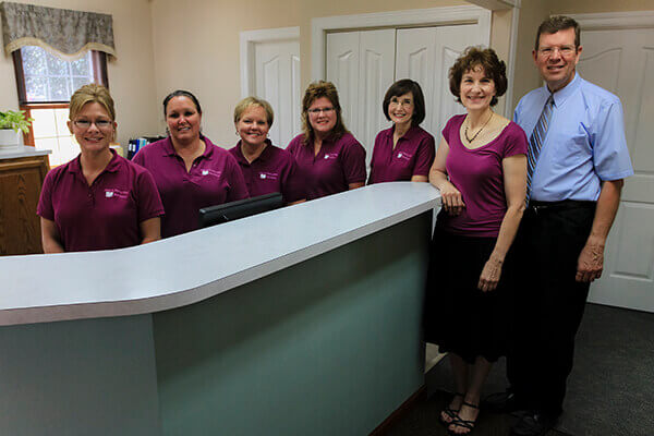 Team members at reception desk