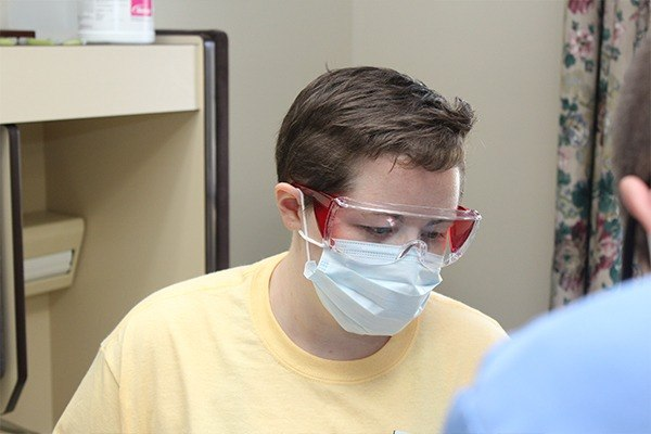 Closeup of dental team member concentrating on patient