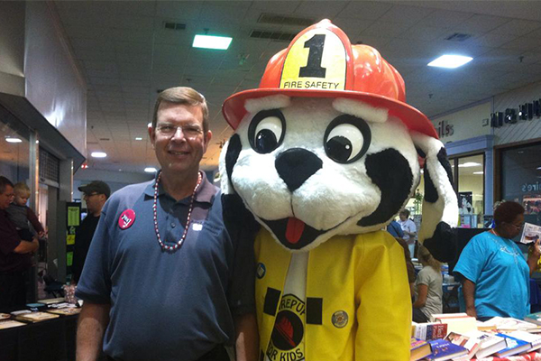 Dentist and fire dog mascot