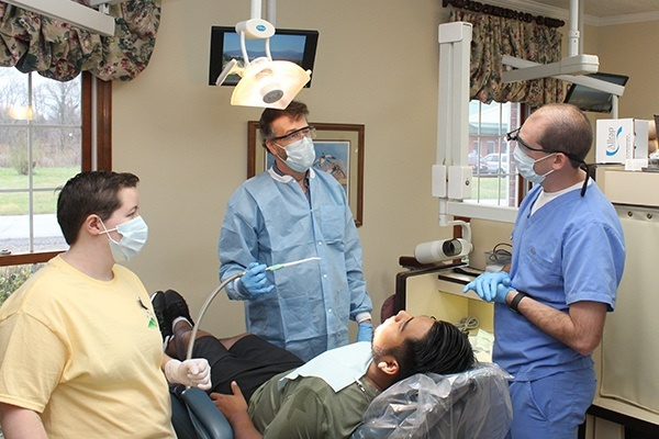 Dentist and team members treating patient