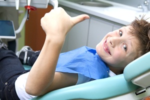 Smiling child in dentist's chair