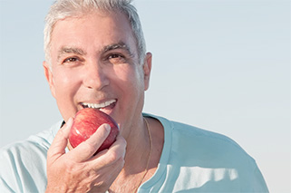 Mature man enjoying an apple.