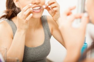 a woman using DIY whitening in Tullahoma to brighten her teeth